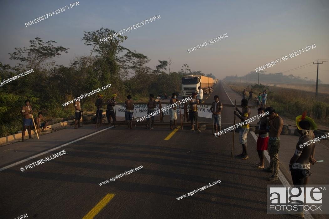Stock Photo: 17 August 2020, Brazil, Novo Progresso: Members of the indigenous Kayapó people block the BR-163 highway and prevent vehicles from passing through.