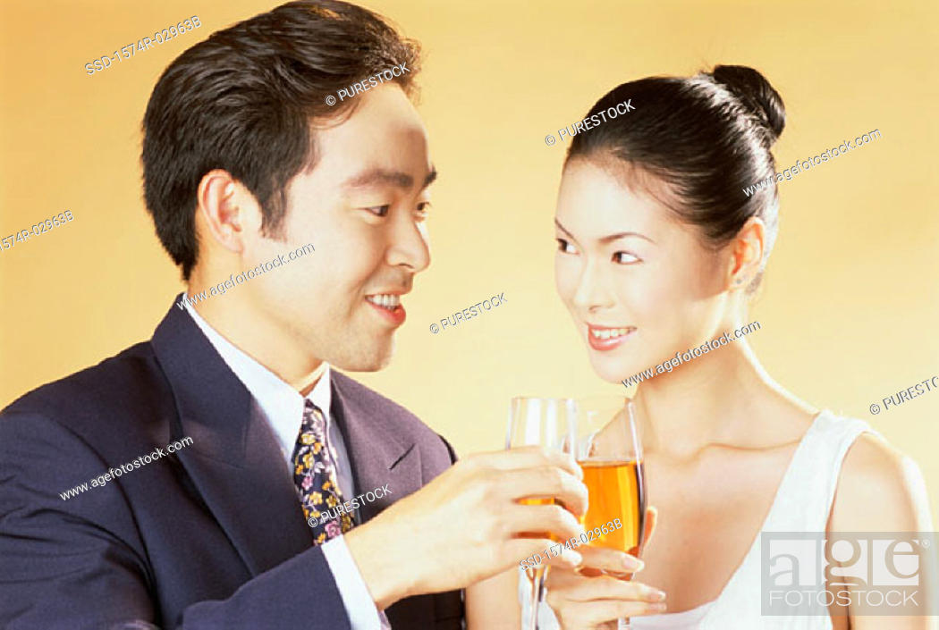 Stock Photo: Close-up of a young couple toasting.