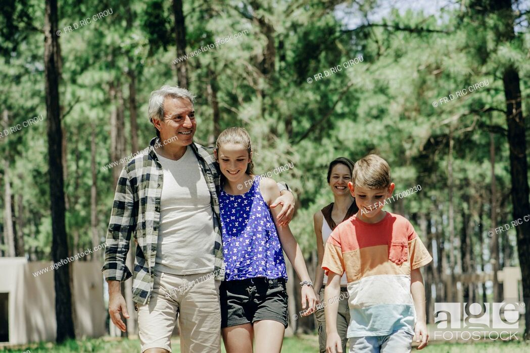 Stock Photo: Family walking in forest.