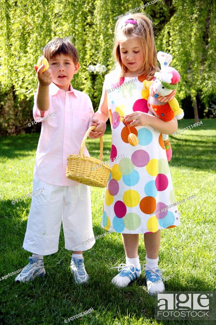 Stock Photo: Boy and girl playing in the yard.