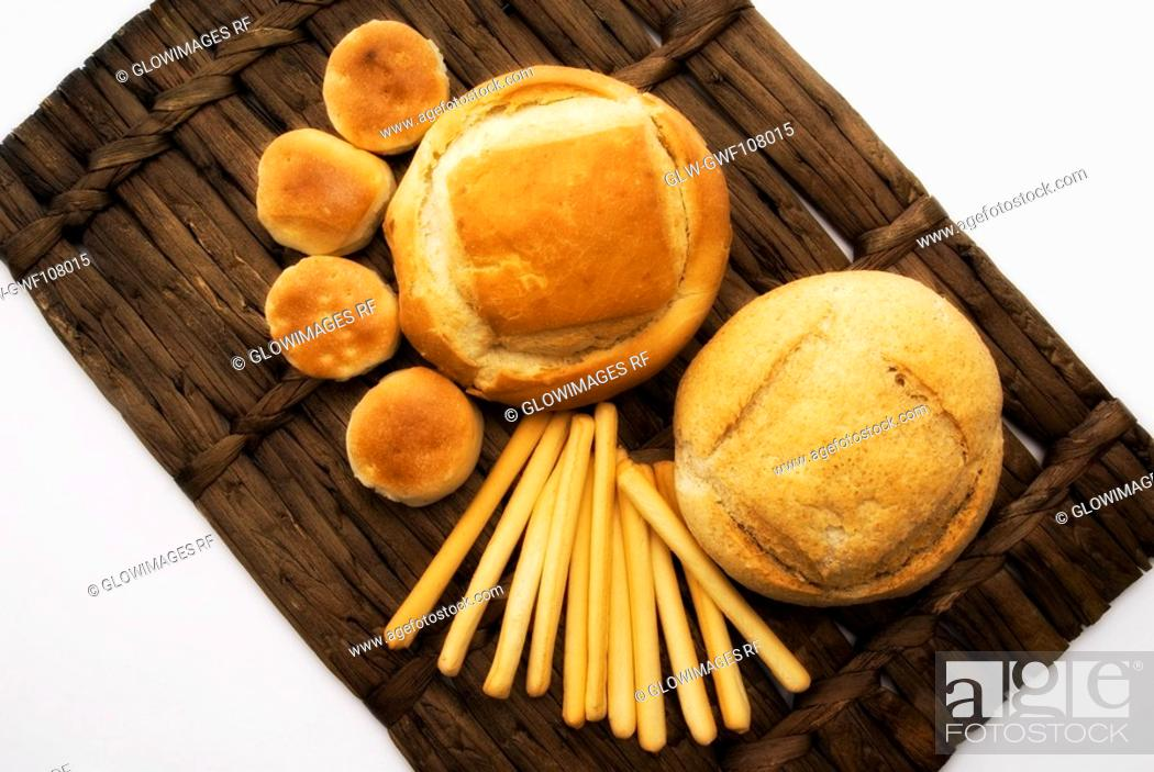 Stock Photo: Close-up of assorted breads on a wicker mat.