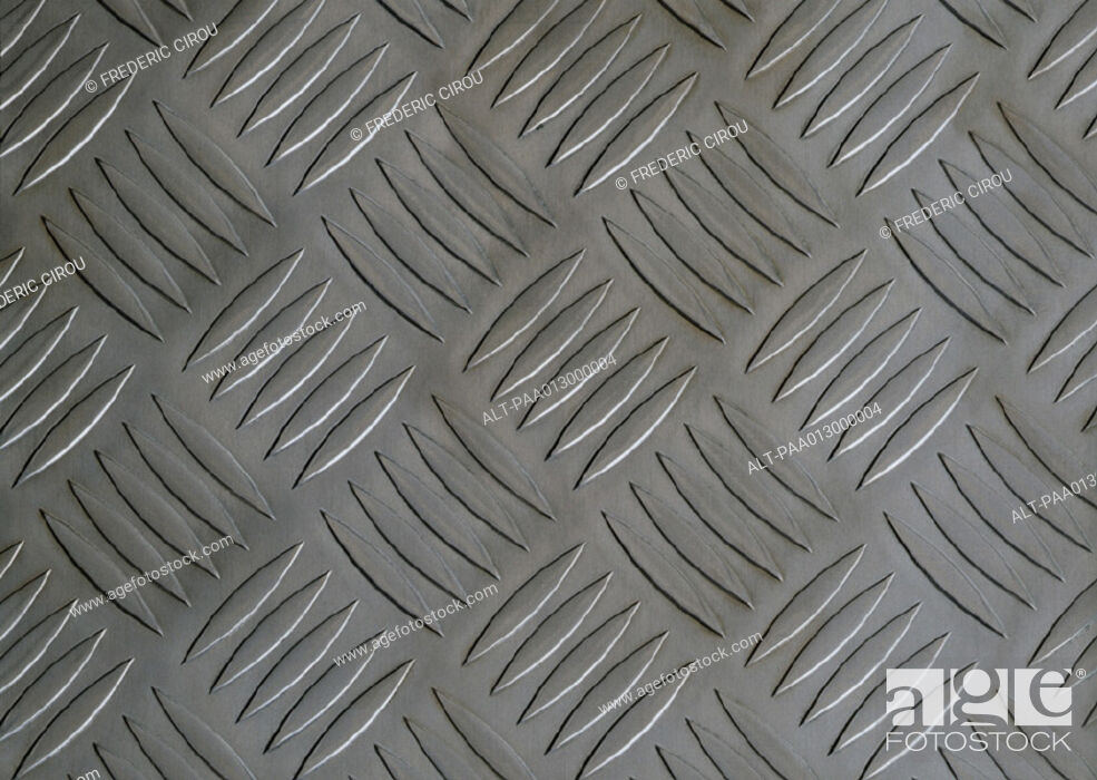Stock Photo: Repetitive pattern on metal plate, close-up, full frame.