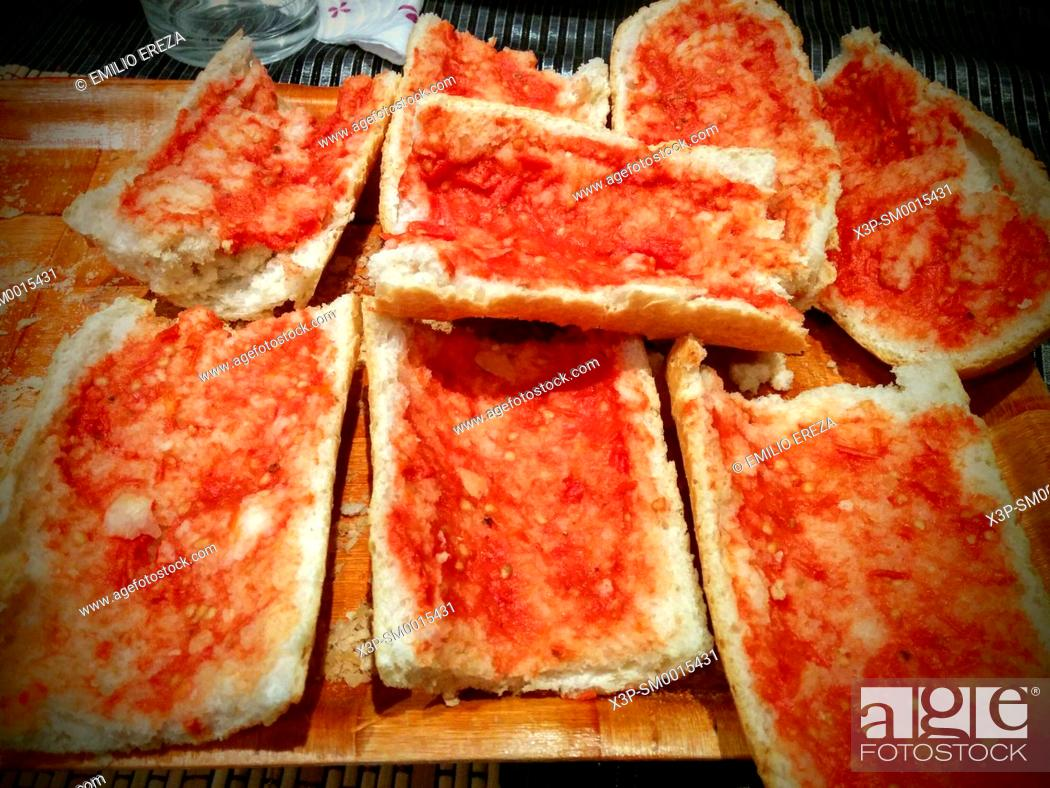 Stock Photo: Bread smeared with tomato.