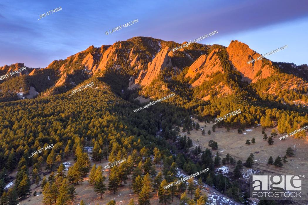 Stock Photo: Aerial photo just after sunrise on Green Mountain with the Flatirons illuminated above Boulder, Colorado in winter.