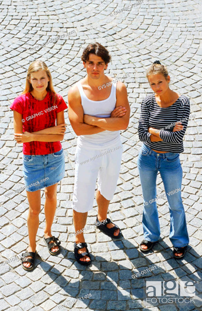 Stock Photo: Portrait of Young man standing with two young women.