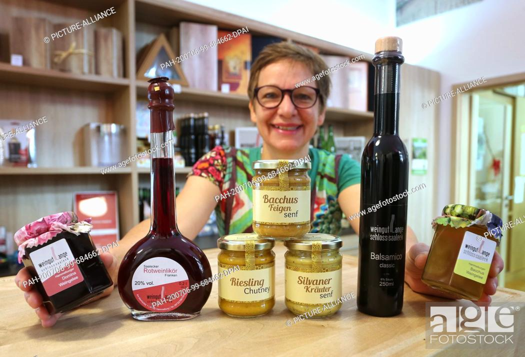 "Stock Photo: 12 June 2020, Bavaria, Hammelburg: Ulrike Lange, winemaker, presents several of her products made with Franconian wine (to dpa: """"Sausage."