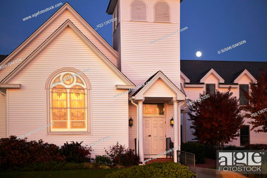 Stock Photo: A church at sunset with a rising full moon on Solomon's Island, Maryland.