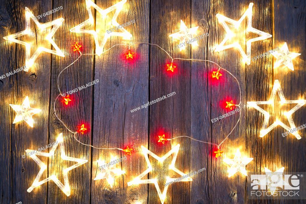 Imagen: Christmas background postcard vintage stars on wooden background.