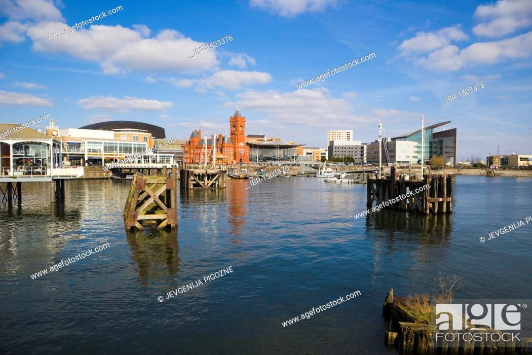 Stock Photo: Mermaid Quay, The Pierhead Building, The Senedd, National Assembly building, Atradius headquarters over Inner Harbour, Cardiff Bay, Caerdydd, South Glamorgan.
