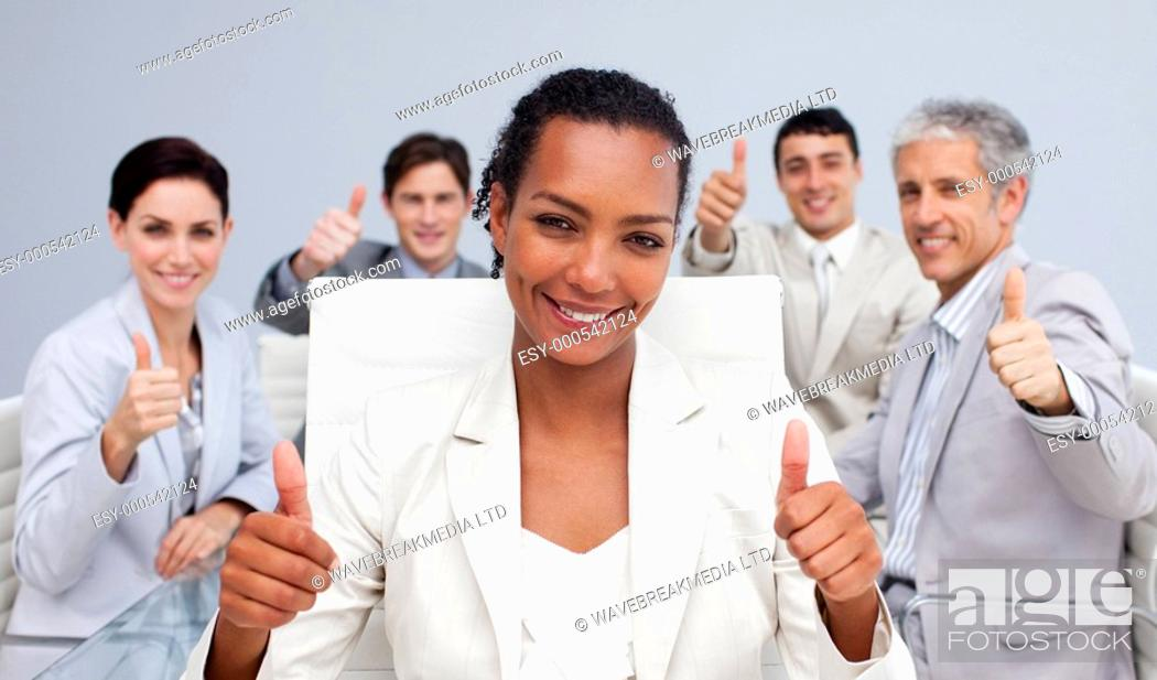 Stock Photo: Happy business team celebrating a sucess with thumbs up in the office.