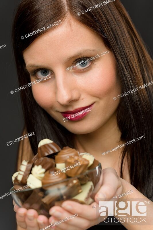Stock Photo: Chocolate - portrait young woman hold candy.