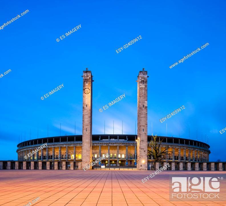 Stock Photo: Berlin's Olympiastadion seen at twilight.