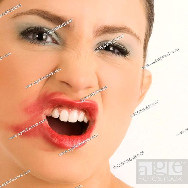 Stock Photo: Portrait of a young woman with her messy lips.