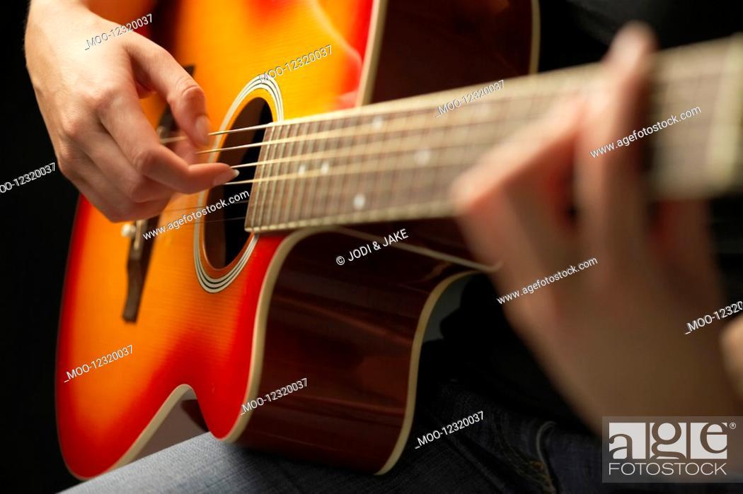 Stock Photo: Woman Playing Guitar detail close-up.