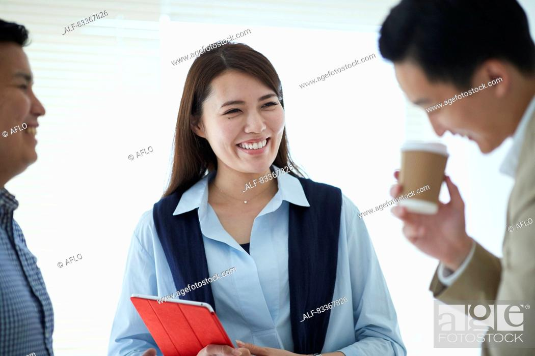Stock Photo: Japanese business people at work.