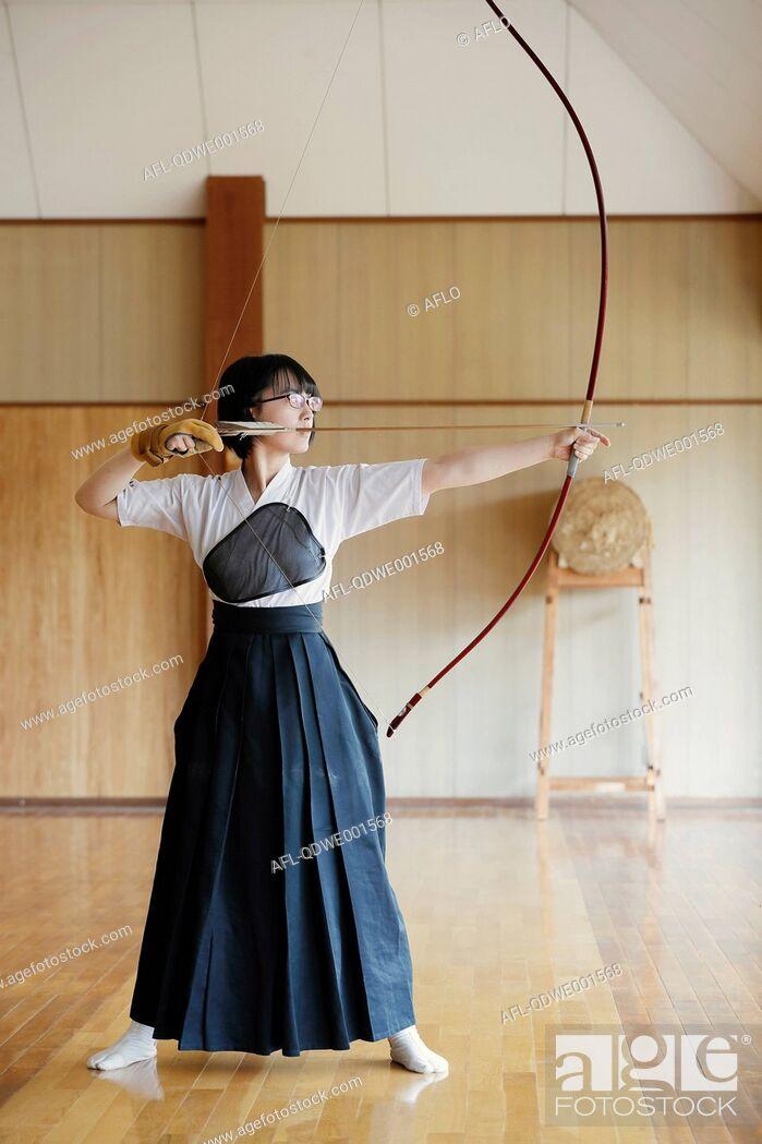 Stock Photo: Japanese traditional Kyudo archery athlete practicing.