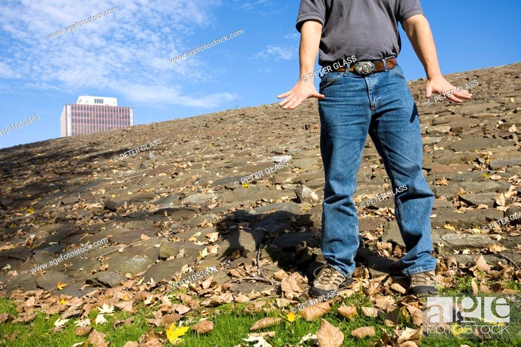 Stock Photo: Close-up of a young man standing on a rocky area.