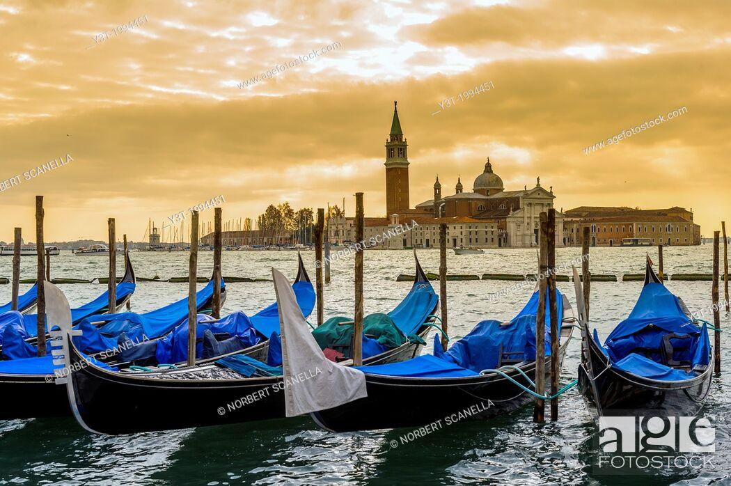 Stock Photo: Europe, Italy, Veneto, Venice, classified as World Heritage by UNESCO. Gondola and the church San Giorgio Maggiore at sunset.