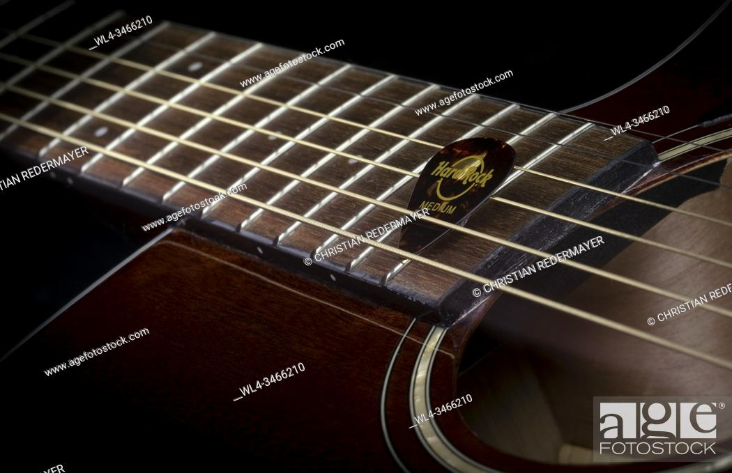 Stock Photo: Close up image form a classic guitar on a black background painted with light.