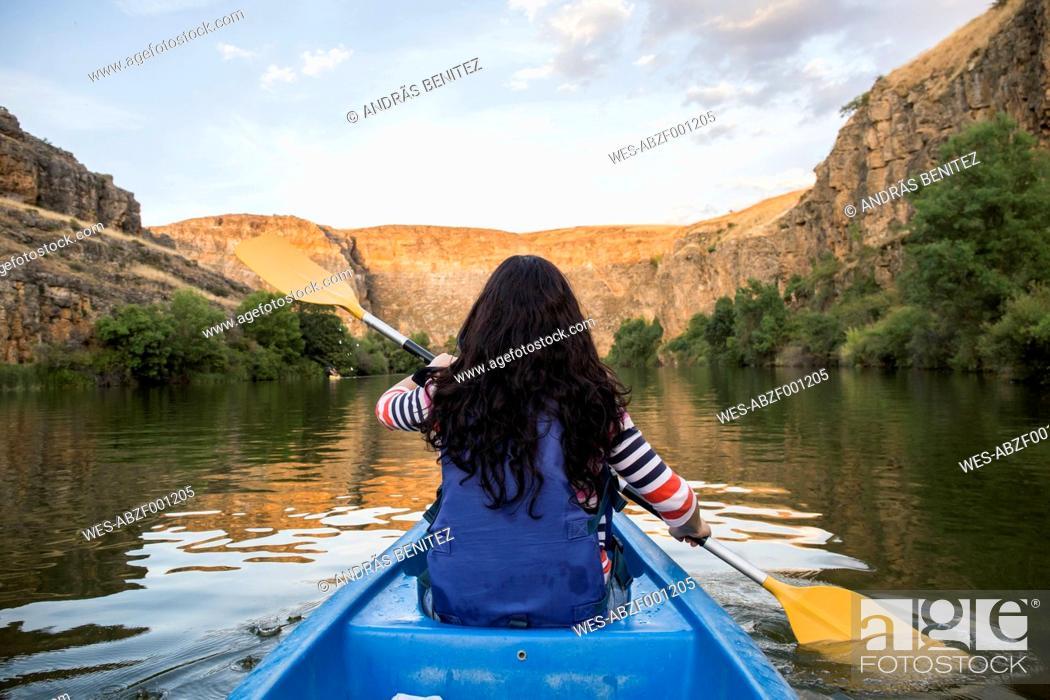 Stock Photo: Spain, Segovia, Woman in a canoe in Las Hoces del Rio Duraton.