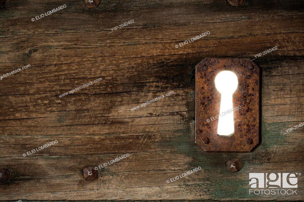 Stock Photo: Detail of an Old Door with Rusty Keyhole. Civita di Bagnoregio, Viterbo District, Lazio, Italy.