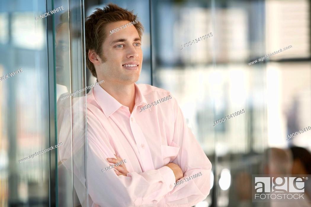 Stock Photo: Young Businessman in Office.