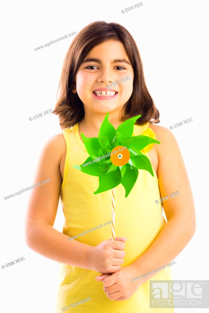 Stock Photo: Little girl playing with a toy windmill.