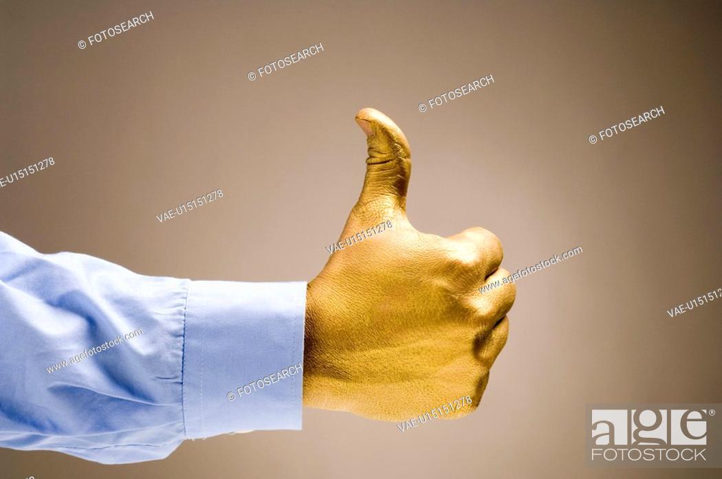 Stock Photo: gilded, gilt, gold, golden, hand, goldy, human.
