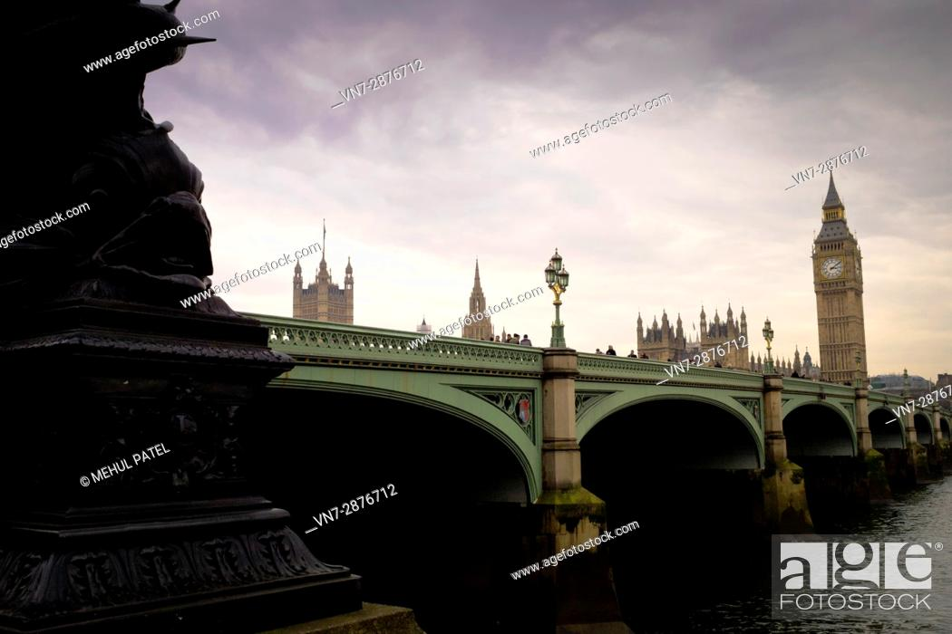 Stock Photo: Westminster Bridge - London, at dusk. The bridge provides road and foot links across the river Thames joining north and south London.
