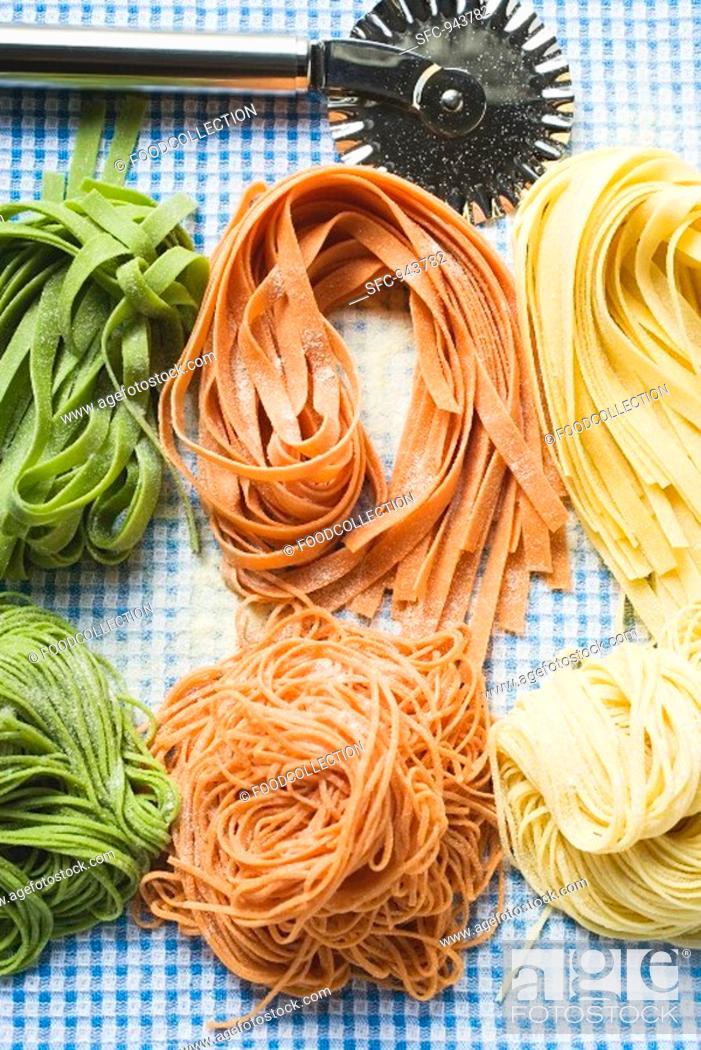Stock Photo: Ribbon pasta and spaghetti in three colours.