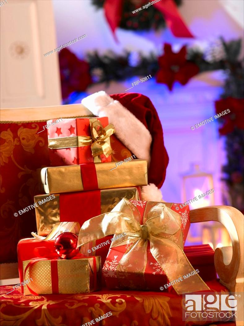 Stock Photo: Christmas gifts on a chair.