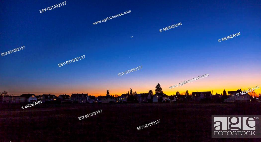 Stock Photo: sunset in Munich in suburban living area with moon.