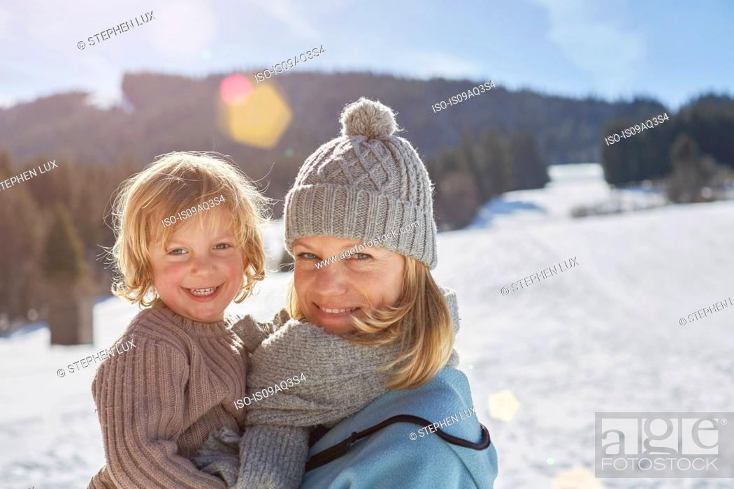 Photo de stock: Mother and son enjoying day out in snow.
