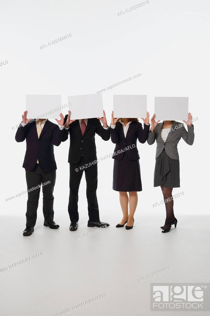 Stock Photo: Young Japanese business people holding white boards.