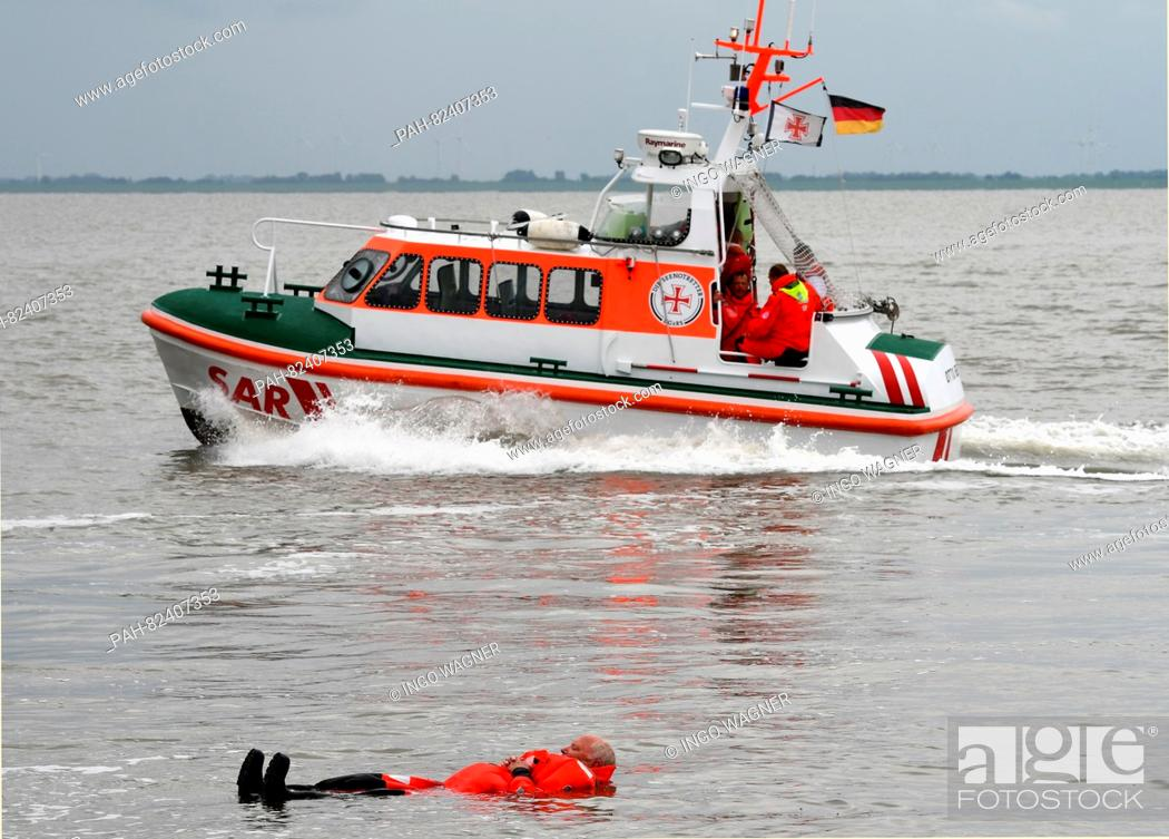 """Stock Photo: Rescue worker in the rescue boat """"""""Otto Behr"""""""" from the German Society for Sea Rescue Service (DGzRS) before Wilhelmshaven in the North Sea, Germany."""