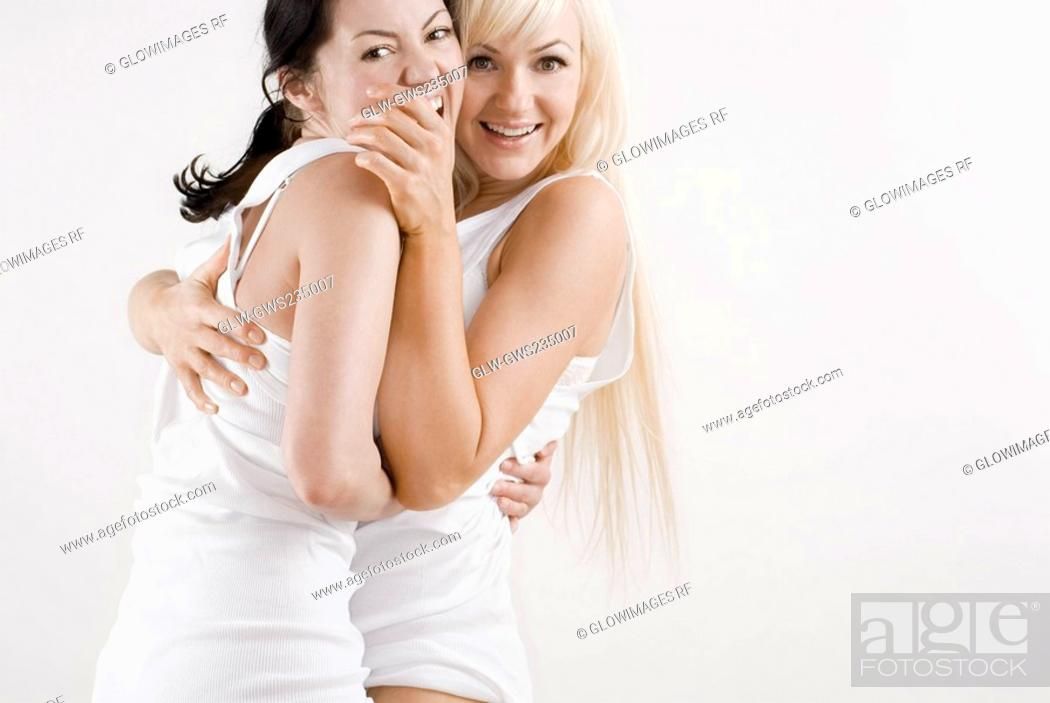 Stock Photo: Portrait female homosexual couple embracing each other and smiling.