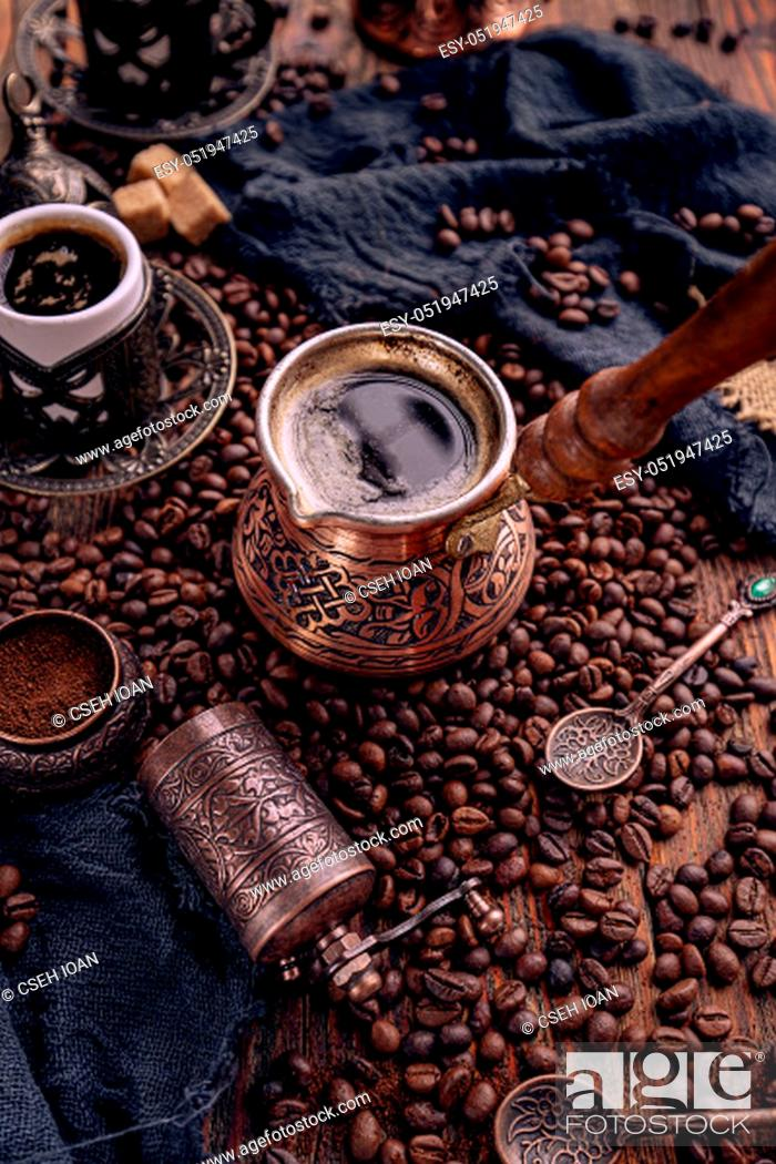 Stock Photo: Turkish coffee pot with roasted coffee beans. Still life.