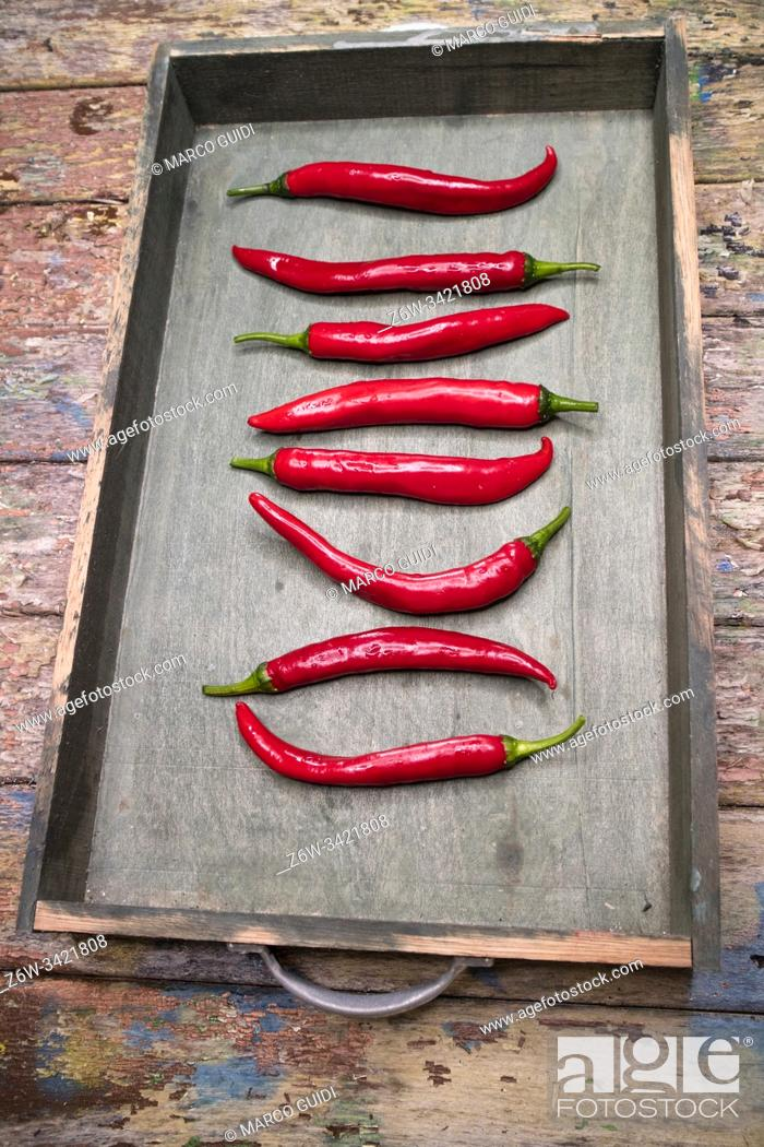 Stock Photo: Photographic representation of some spicy and fresh red peppers.