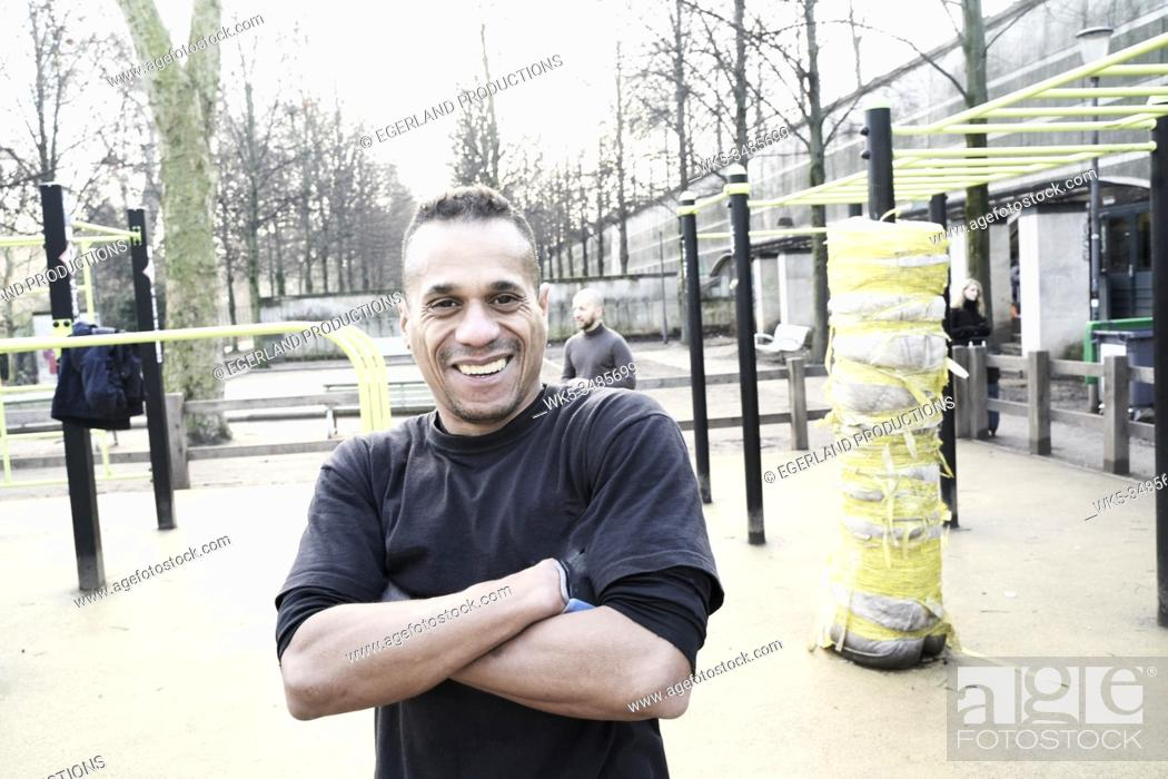 Stock Photo: Mature man training in park. Paris, France.