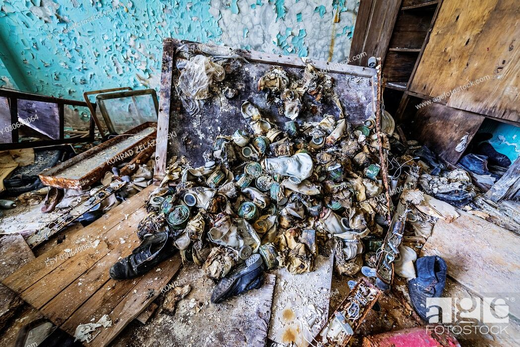 Stock Photo: Old gas masks in abandoned Jupiter Factory in Pripyat ghost town of Chernobyl Nuclear Power Plant Zone of Alienation in Ukraine.