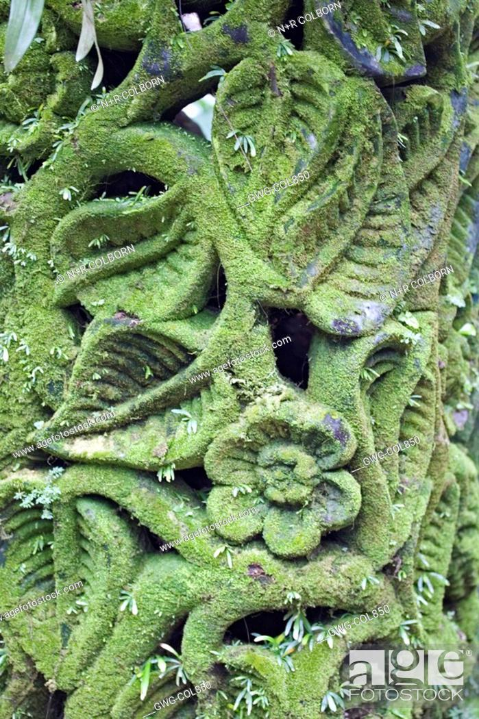 Stock Photo: MOSS ENCRUSTED CARVING AT SINGAPORE NATIONAL ORCHID GARDEN.