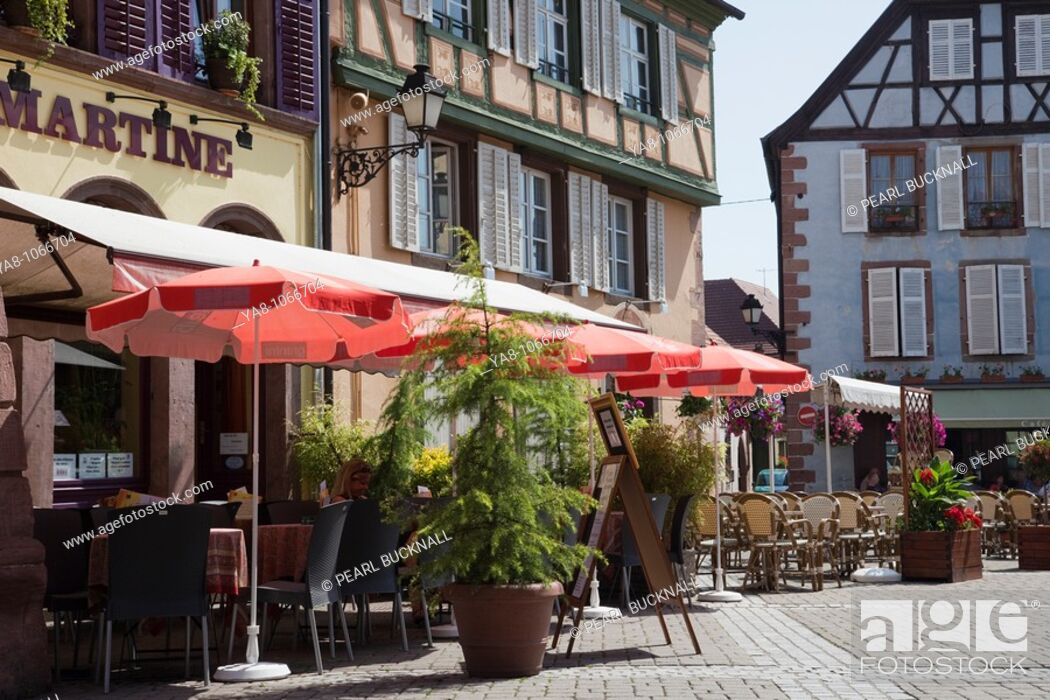 Stock Photo: Ribeauville, Alsace, Haut-Rhin, France, Europe  French pavement cafe outside medieval timbered buildings in picturesque town on the Alsatian wine route.