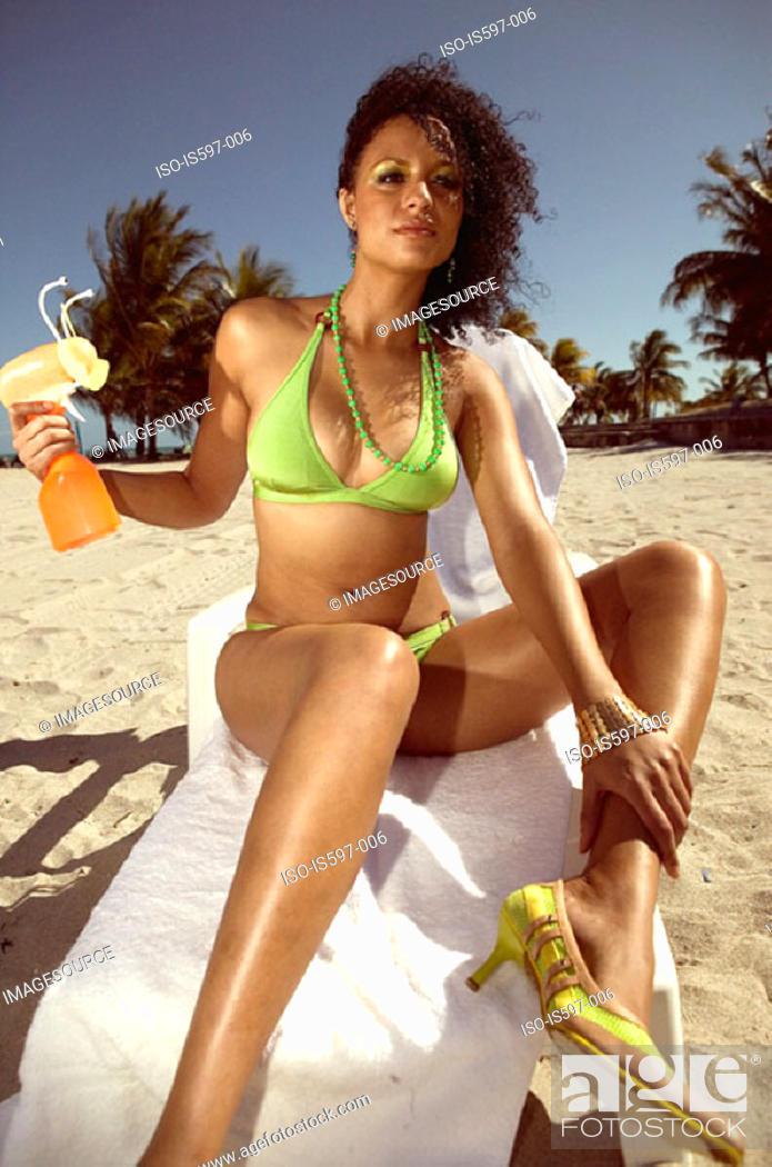 Stock Photo: Woman sunbathing on beach.