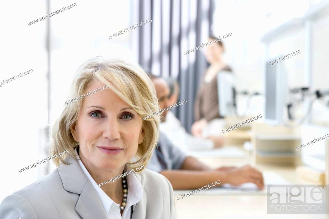 Stock Photo: Smiling businesswoman in office.
