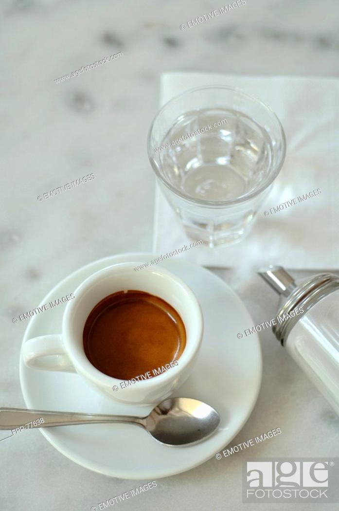 Stock Photo: Espresso, tumbler and sugar dispenser.
