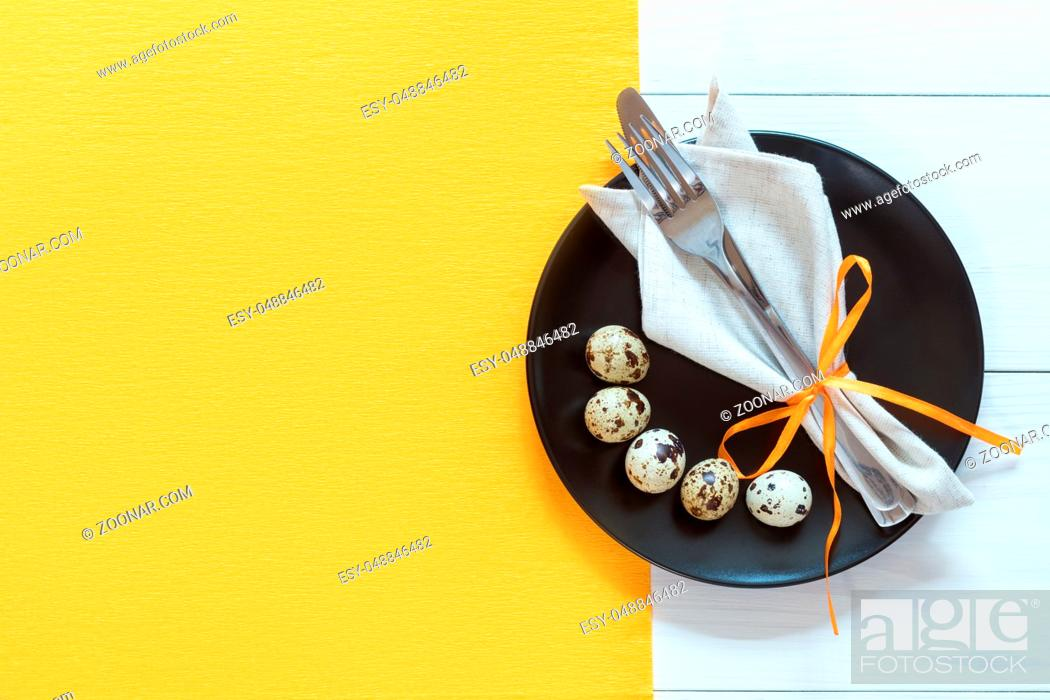 Stock Photo: Easter table setting with cutlery. Rustic orange table cloth on white wood background. Holidays background with copy space.