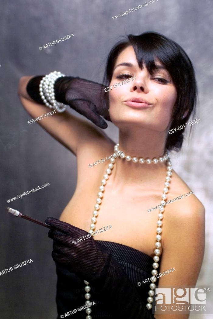 Stock Photo: Girl with pearls.