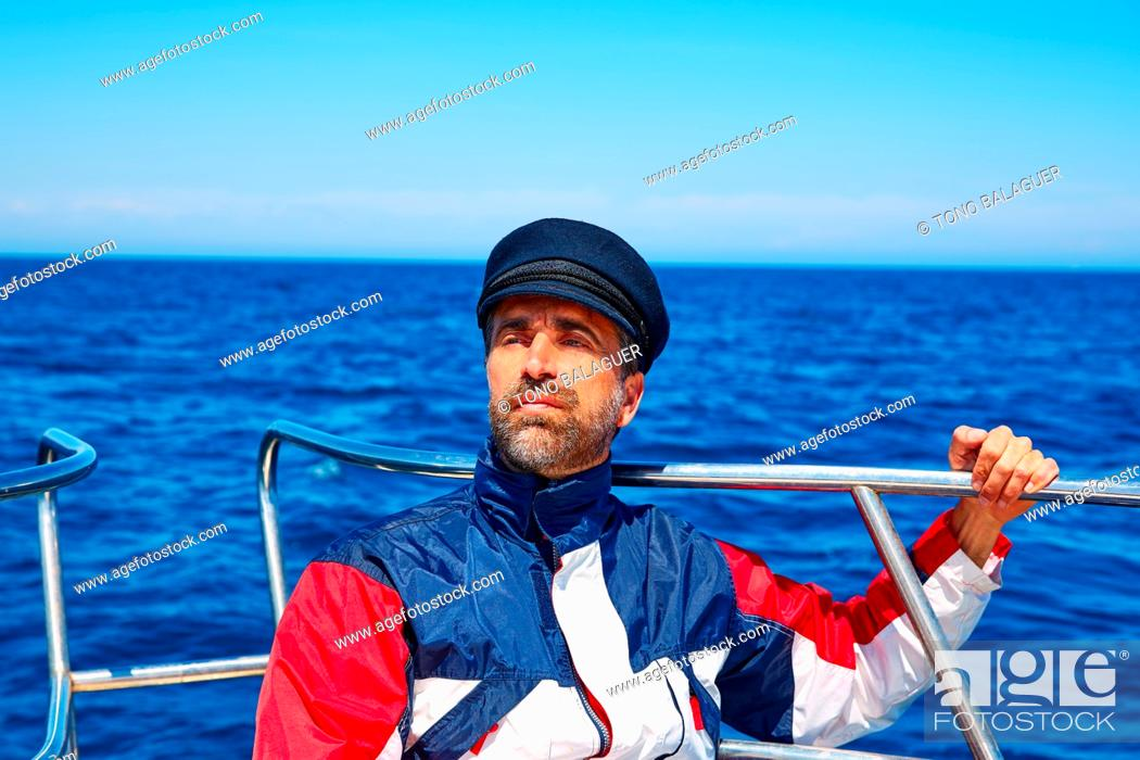 Photo de stock: Beard sailor man sailing sea ocean in a boat with captain cap looking horizon.