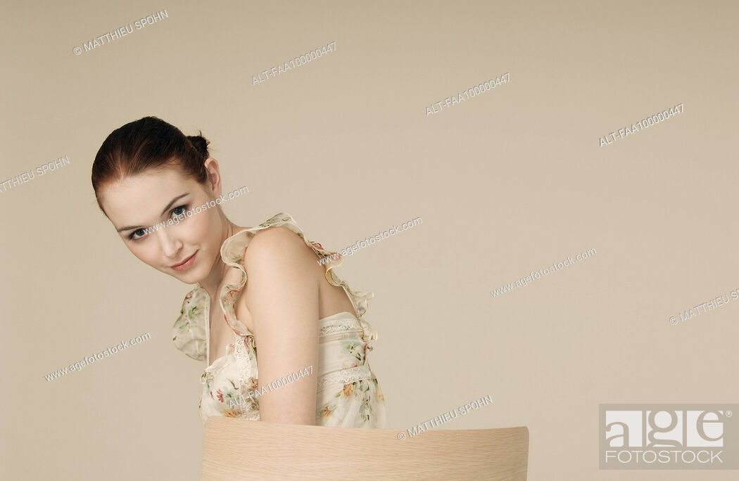 Stock Photo: Young woman looking seductively at camera, portrait.