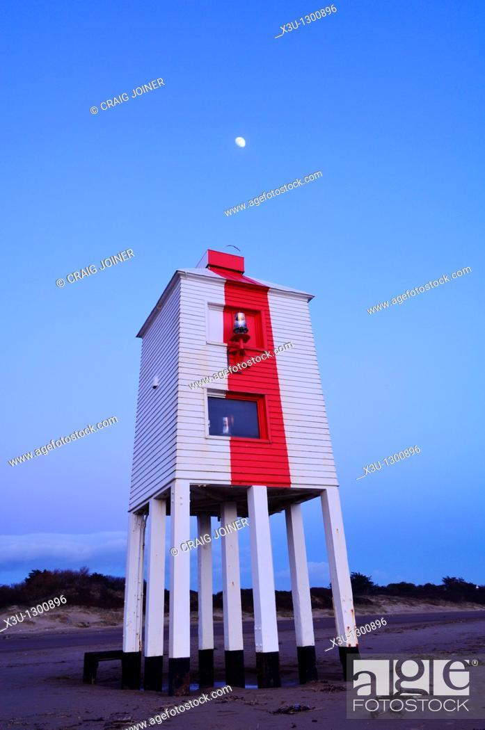 Stock Photo: Burnham-on-Sea Lighthouse at dusk with the moon shining overhead  Somerset, England, United Kingdom.
